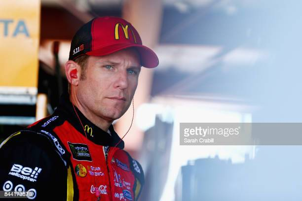 Jamie McMurray driver of the McDonald's Chevrolet looks on from the garage prior to practice for the Monster Energy NASCAR Cup Series Federated Auto...