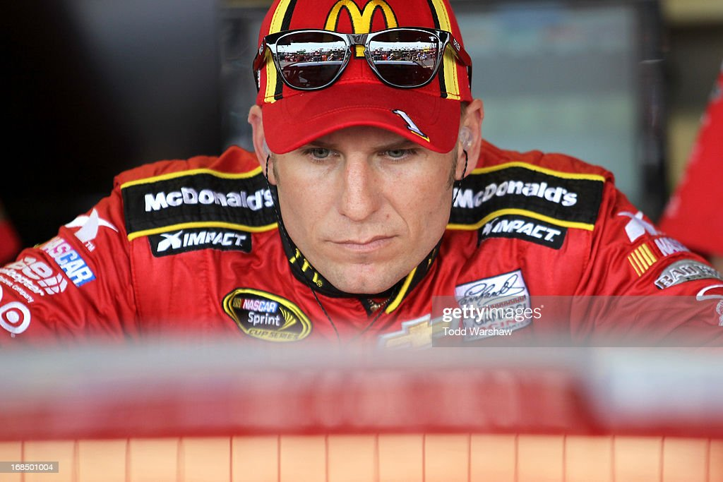 Jamie McMurray, driver of the #1 McDonald's Chevrolet, looks on in the garage during practice for the NASCAR Sprint Cup Series Bojangles' Southern 500 at Darlington Raceway on May 10, 2013 in Darlington, South Carolina.