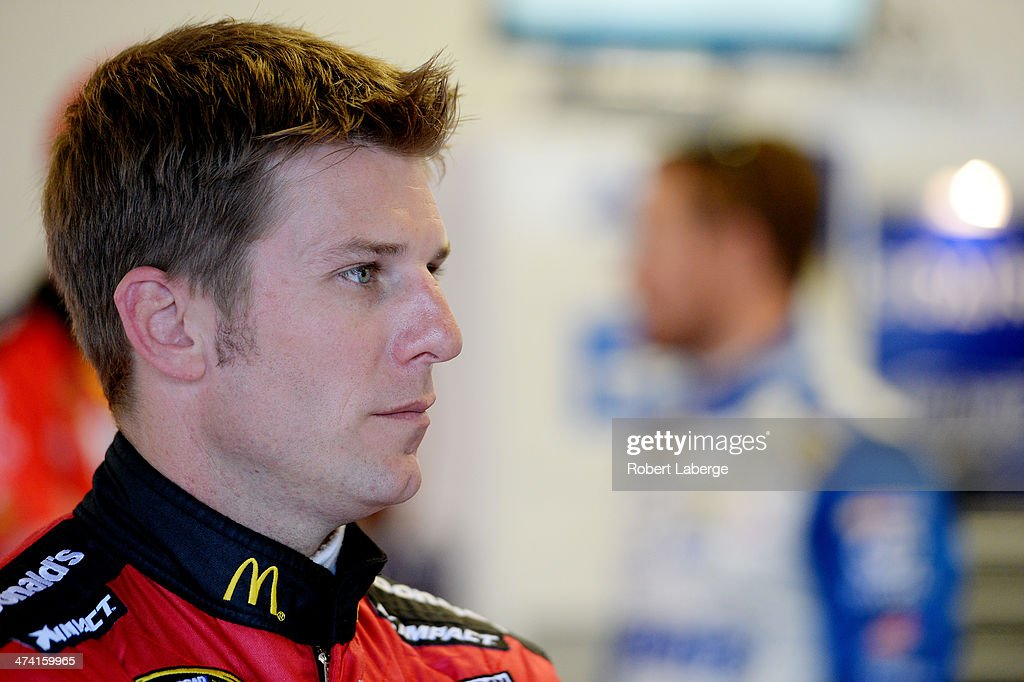 Jamie McMurray, driver of the #1 McDonald's Chevrolet, looks on in the garage area during practice for the NASCAR Sprint Cup Series Daytona 500 at Daytona International Speedway on February 22, 2014 in Daytona Beach, Florida.