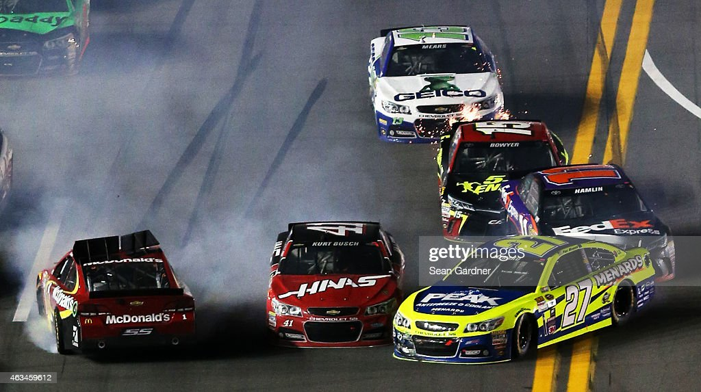 Jamie McMurray driver of the McDonald's Chevrolet Paul Menard driver of the Peak/Menard's Chevrolet Kurt Busch driver of the Haas Automation...