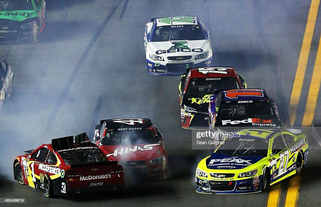 <a gi-track='captionPersonalityLinkClicked' href=/galleries/search?phrase=Jamie+McMurray&family=editorial&specificpeople=198964 ng-click='$event.stopPropagation()'>Jamie McMurray</a>, driver of the #1 McDonald's Chevrolet, <a gi-track='captionPersonalityLinkClicked' href=/galleries/search?phrase=Paul+Menard&family=editorial&specificpeople=540271 ng-click='$event.stopPropagation()'>Paul Menard</a>, driver of the #27 Peak/Menard's Chevrolet, <a gi-track='captionPersonalityLinkClicked' href=/galleries/search?phrase=Kurt+Busch&family=editorial&specificpeople=201728 ng-click='$event.stopPropagation()'>Kurt Busch</a>, driver of the #41 Haas Automation Chevrolet, <a gi-track='captionPersonalityLinkClicked' href=/galleries/search?phrase=Denny+Hamlin&family=editorial&specificpeople=504674 ng-click='$event.stopPropagation()'>Denny Hamlin</a>, driver of the #11 FedEx Express Toyota, <a gi-track='captionPersonalityLinkClicked' href=/galleries/search?phrase=Clint+Bowyer&family=editorial&specificpeople=537951 ng-click='$event.stopPropagation()'>Clint Bowyer</a>, driver of the #15 5-hour ENERGY Toyota, and <a gi-track='captionPersonalityLinkClicked' href=/galleries/search?phrase=Casey+Mears&family=editorial&specificpeople=176485 ng-click='$event.stopPropagation()'>Casey Mears</a>, driver of the #13 GEICO Chevrolet, have an on track incident during the 3rd Annual Sprint Unlimited at Daytona at Daytona International Speedway on February 14, 2015 in Daytona Beach, Florida.