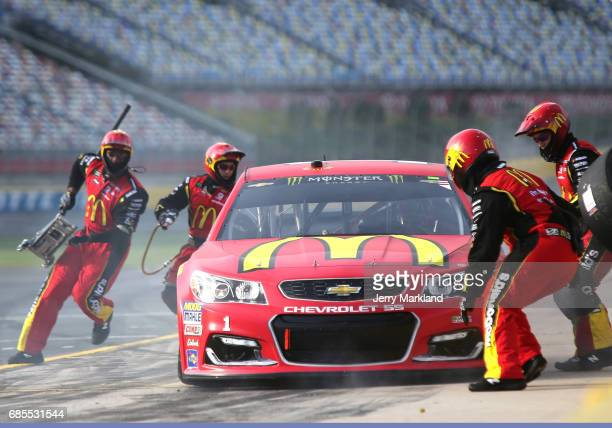Jamie McMurray driver of the McDonald's Chevrolet pits during qualifying for the Monster Energy NASCAR AllStar Race at Charlotte Motor Speedway on...