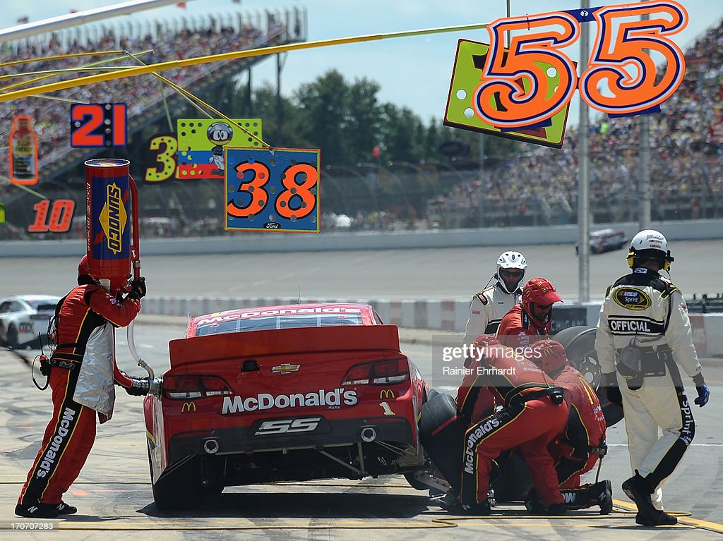 Jamie McMurray, driver of the #1 McDonald's Chevrolet, pits during the NASCAR Sprint Cup Series Quicken Loans 400 at Michigan International Speedway on June 16, 2013 in Brooklyn, Michigan.