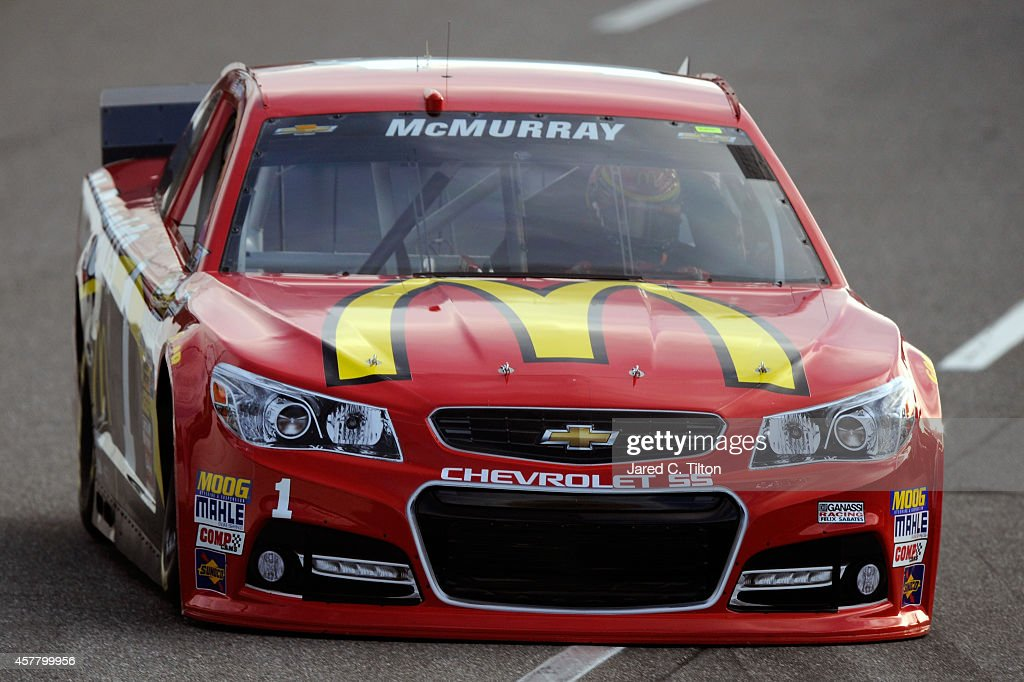 <a gi-track='captionPersonalityLinkClicked' href=/galleries/search?phrase=Jamie+McMurray&family=editorial&specificpeople=198964 ng-click='$event.stopPropagation()'>Jamie McMurray</a>, driver of the #1 McDonald's Chevrolet, qualifies for the NASCAR Sprint Cup Series Goody's Headache Relief Shot 500 at Martinsville Speedway on October 24, 2014 in Martinsville, Virginia.