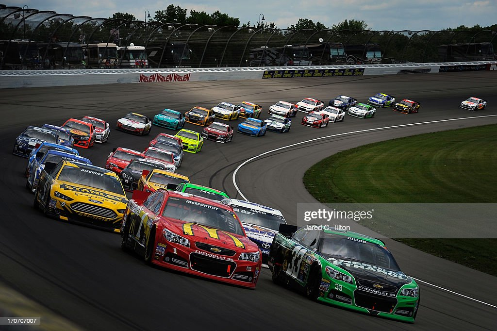 Jamie McMurray, driver of the #1 McDonald's Chevrolet, races Austin Dillon, driver of the #33 American Ethanol Chevrolet, during the NASCAR Sprint Cup Series Quicken Loans 400 at Michigan International Speedway on June 16, 2013 in Brooklyn, Michigan.