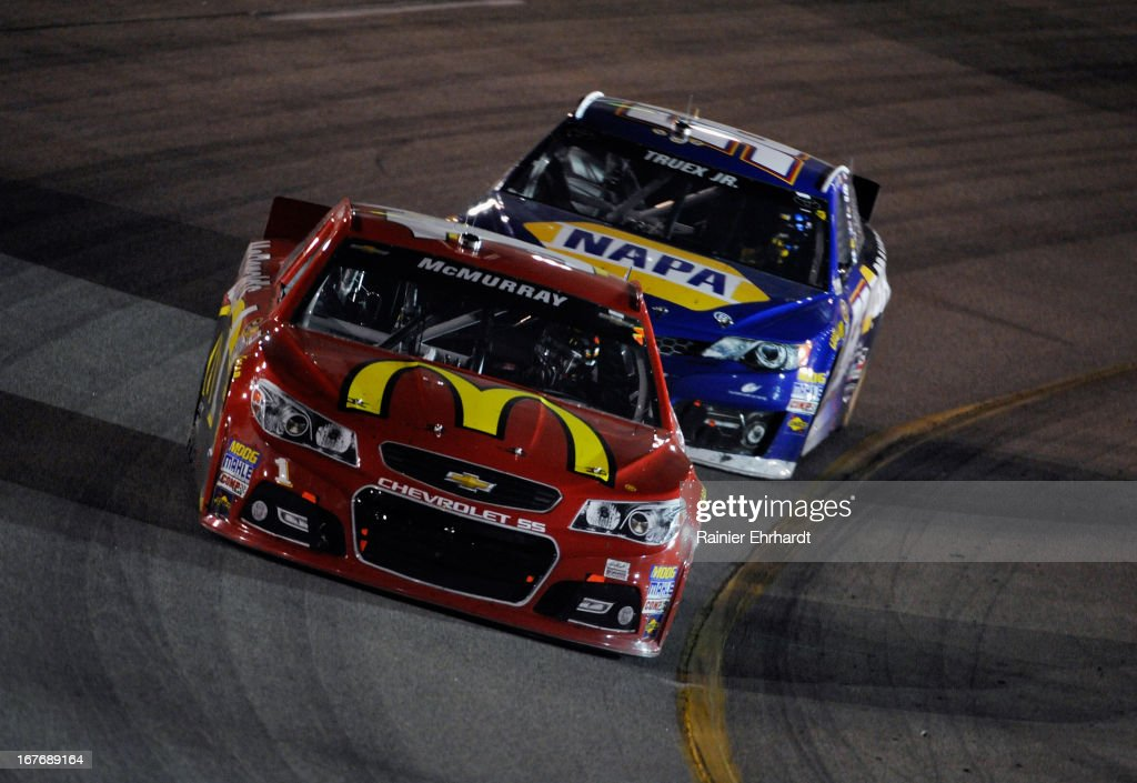 Jamie McMurray, driver of the #1 McDonald's Chevrolet, races Martin Truex Jr., driver of the #56 NAPA Brakes Toyota, during the NASCAR Sprint Cup Series Toyota Owners 400 at Richmond International Raceway on April 27, 2013 in Richmond, Virginia.