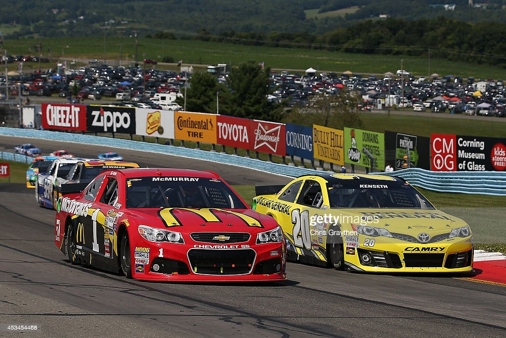 Jamie McMurray, driver of the #1 McDonald's Chevrolet, races Matt Kenseth, driver of the #20 Dollar General Toyota, during the NASCAR Sprint Cup Series Cheez-It 355 at Watkins Glen International on August 10, 2014 in Watkins Glen, New York.