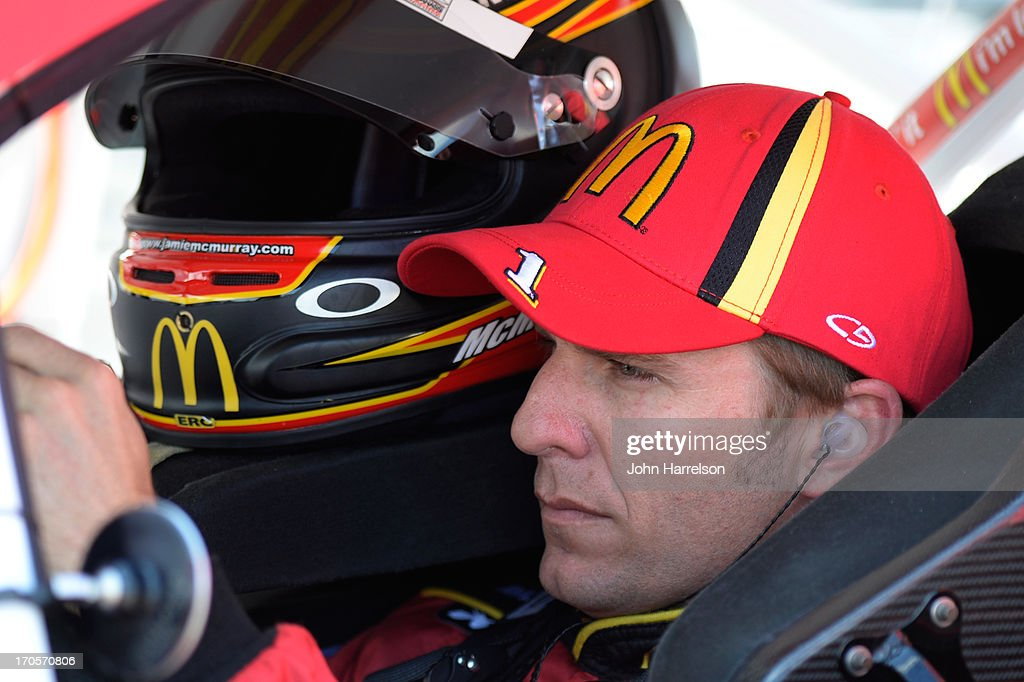 Jamie McMurray, driver of the #1 McDonald's Chevrolet, sits in his car during qualifying for the NASCAR Sprint Cup Series Quicken Loans 400 at Michigan International Speedway on June 14, 2013 in Brooklyn, Michigan.