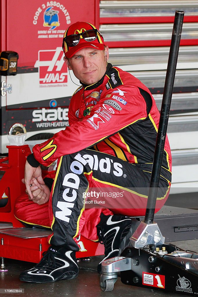Jamie McMurray, driver of the #1 McDonald's Chevrolet, sits in the garage area during practice for the NASCAR Sprint Cup Series Quicken Loans 400 at Michigan International Speedway on June 15, 2013 in Brooklyn, Michigan.