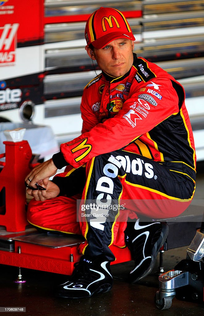 Jamie McMurray, driver of the #1 McDonald's Chevrolet, sits in the garage during practice for the NASCAR Sprint Cup Series Quicken Loans 400 at Michigan International Speedway on June 15, 2013 in Brooklyn, Michigan.