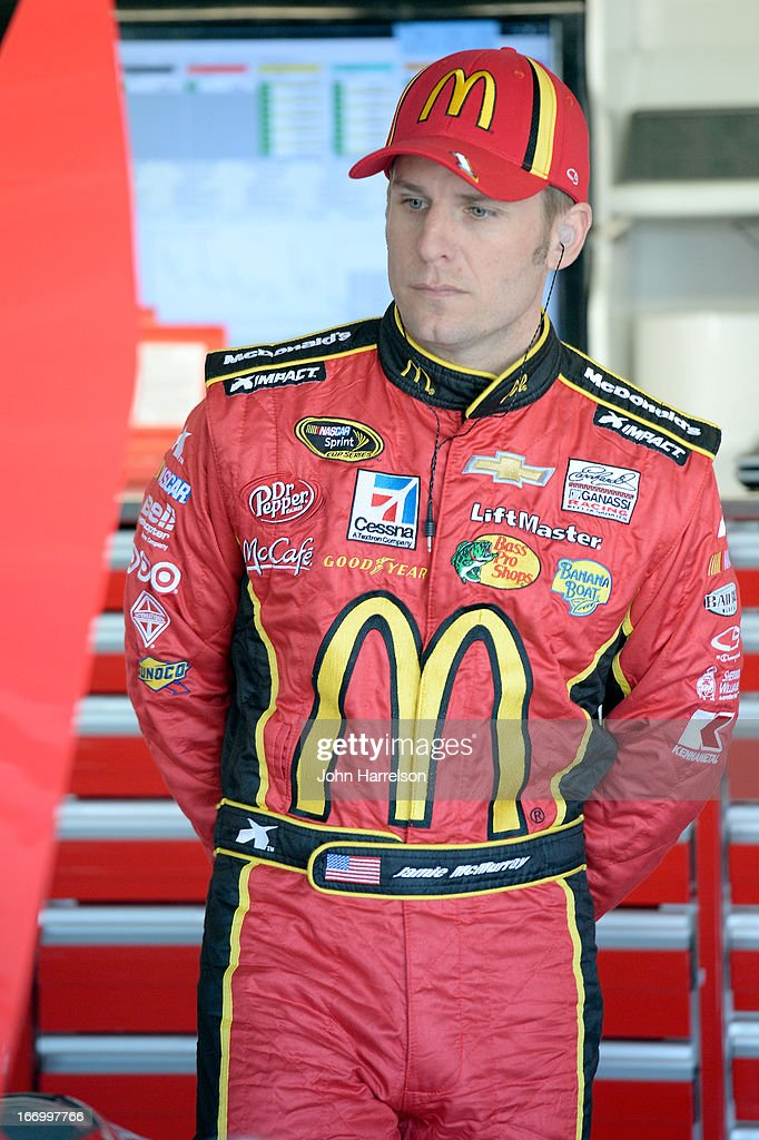 Jamie McMurray, driver of the #1 McDonald's Chevrolet, stands in the garage during practice for the NASCAR Sprint Cup Series STP 400 at Kansas Speedway on April 19, 2013 in Kansas City, Kansas.