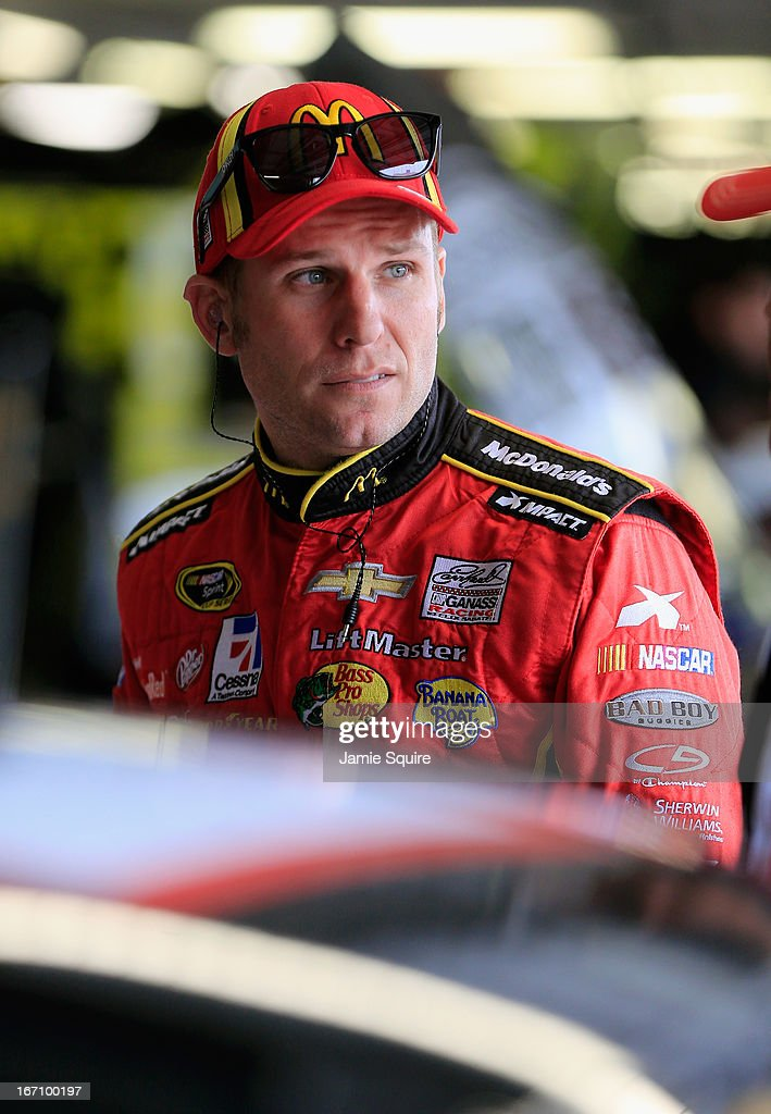 Jamie McMurray, driver of the #1 McDonald's Chevrolet, stands in the garage area during practice for the NASCAR Sprint Cup Series STP 400 at Kansas Speedway on April 20, 2013 in Kansas City, Kansas.