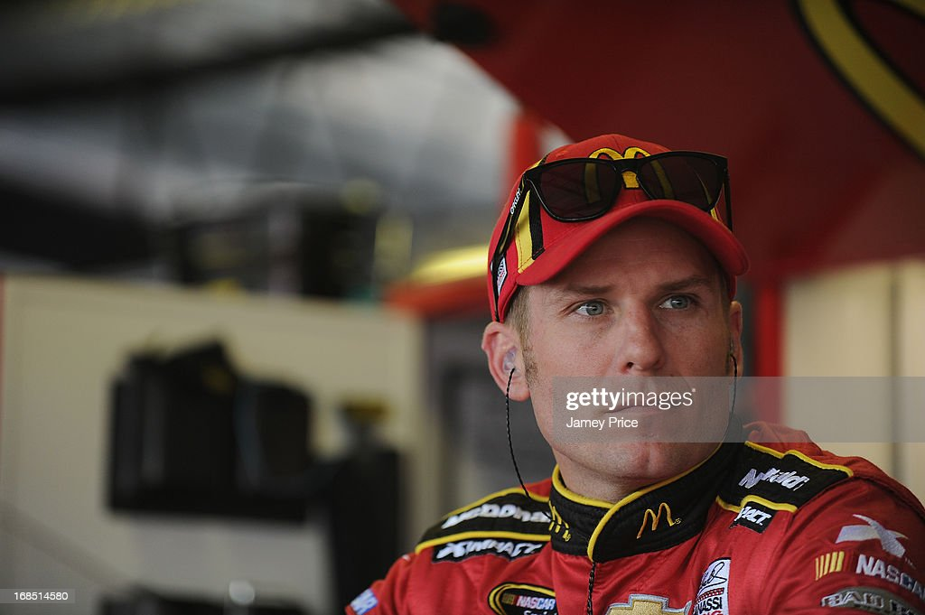 Jamie McMurray, driver of the #1 McDonald's Chevrolet, stands in the garage area during practice for the NASCAR Sprint Cup Series Bojangles' Southern 500 at Darlington Raceway on May 10, 2013 in Darlington, South Carolina.