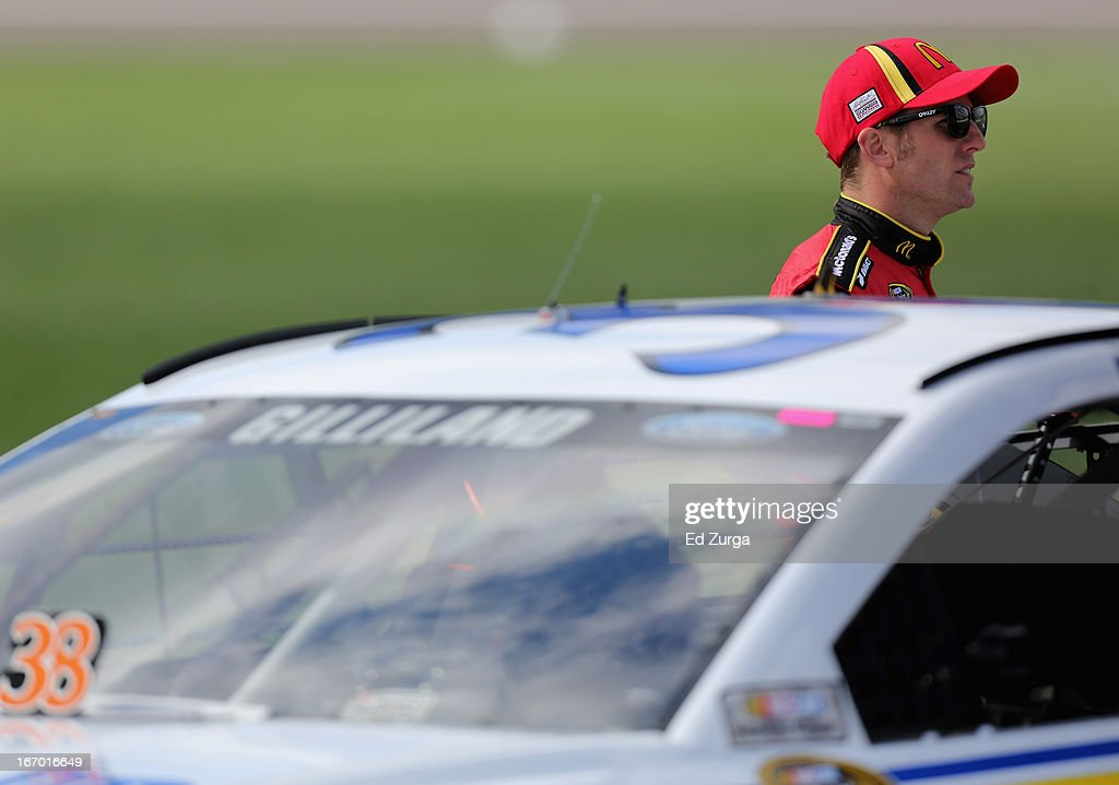 Jamie McMurray, driver of the #1 McDonald's Chevrolet, stands on the grid during qualifying for the NASCAR Sprint Cup Series STP 400 at Kansas Speedway on April 19, 2013 in Kansas City, Kansas.