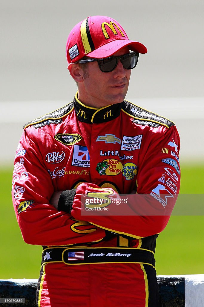 Jamie McMurray, driver of the #1 McDonald's Chevrolet, stands on the grid during qualifying for the NASCAR Sprint Cup Series Quicken Loans 400 at Michigan International Speedway on June 14, 2013 in Brooklyn, Michigan.