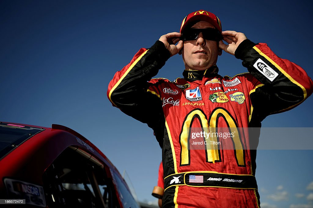Jamie McMurray, driver of the #1 McDonald's Chevrolet, stands on the grid after qualifying for the NASCAR Sprint Cup Series AAA Texas 500 at Texas Motor Speedway on November 1, 2013 in Fort Worth, Texas.