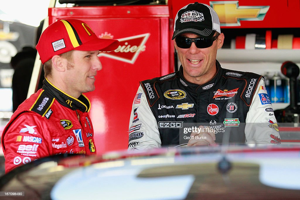 Jamie McMurray, driver of the #1 McDonald's Chevrolet, talks to Kevin Harvick, driver of the #29 Bad Boy Buggies Chevrolet, during practice for the NASCAR Sprint Cup Series STP 400 at Kansas Speedway on April 20, 2013 in Kansas City, Kansas.