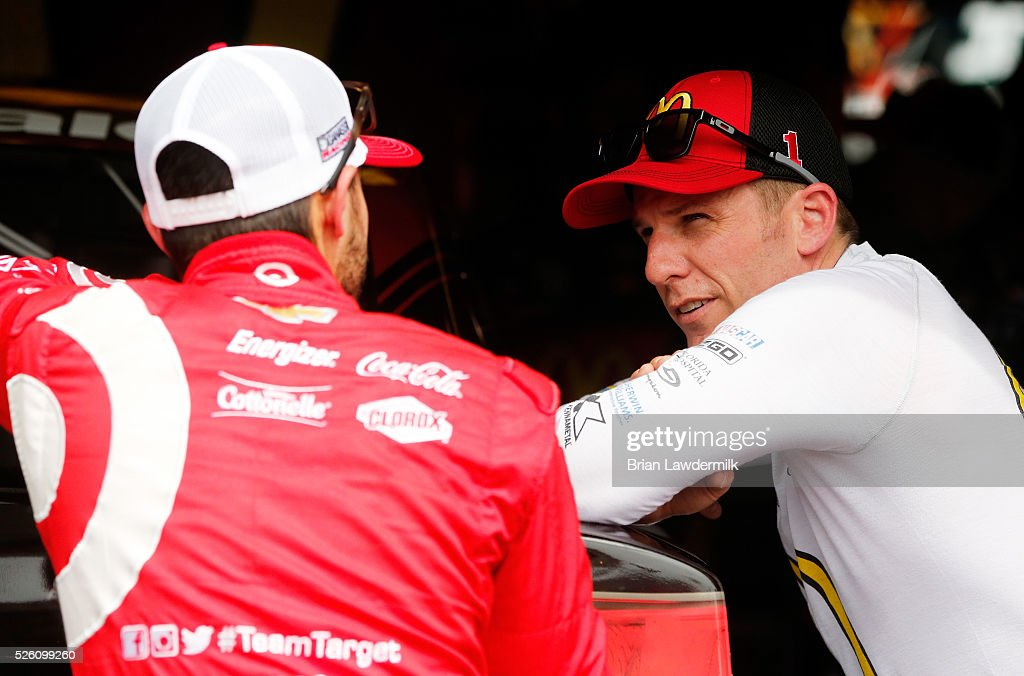 Jamie McMurray, driver of the #1 McDonald's Chevrolet, talks to Kyle Larson, driver of the #42 Target Chevrolet, in the garage area during practice for the NASCAR Sprint Cup Series GEICO 500 at Talladega Superspeedway on April 29, 2016 in Talladega, Alabama.