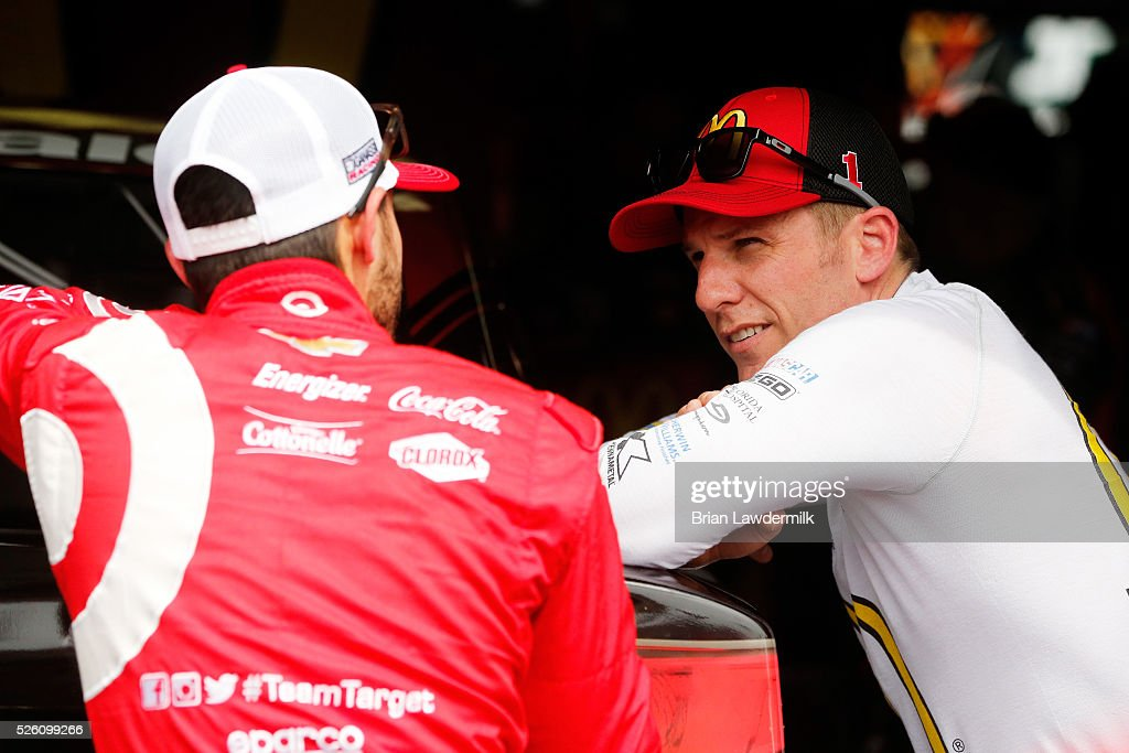 <a gi-track='captionPersonalityLinkClicked' href=/galleries/search?phrase=Jamie+McMurray&family=editorial&specificpeople=198964 ng-click='$event.stopPropagation()'>Jamie McMurray</a>, driver of the #1 McDonald's Chevrolet, talks to Kyle Larson, driver of the #42 Target Chevrolet, in the garage area during practice for the NASCAR Sprint Cup Series GEICO 500 at Talladega Superspeedway on April 29, 2016 in Talladega, Alabama.