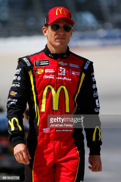 Jamie McMurray driver of the McDonald's Chevrolet walks down pit road during qualifying for the Monster Energy NASCAR Cup Series AAA 400 Drive for...
