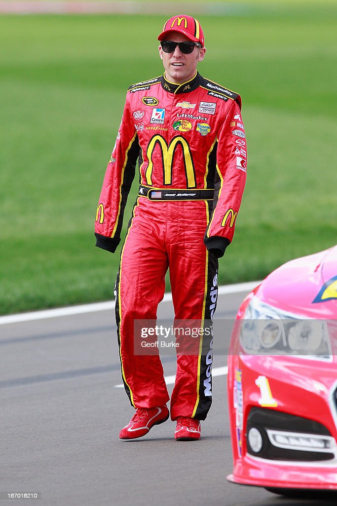 Jamie McMurray, driver of the #1 McDonald's Chevrolet, walks on the grid during qualifying for the NASCAR Sprint Cup Series STP 400 at Kansas Speedway on April 19, 2013 in Kansas City, Kansas.