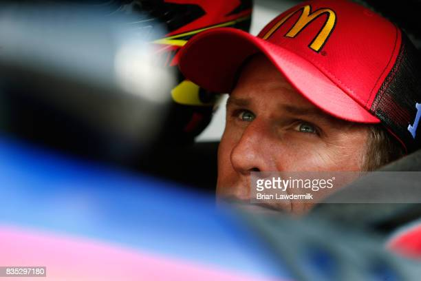 Jamie McMurray driver of the McDonalds/Cessna Chevrolet sits in his car during qualifying for the Monster Energy NASCAR Cup Series Bass Pro Shops NRA...
