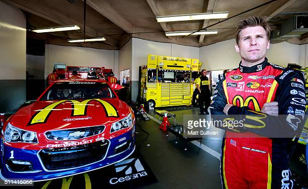 Jamie McMurray driver of the McDonald's/Cessna Chevrolet stands in the garage area during practice for the NASCAR Sprint Cup Series Daytona 500 at...