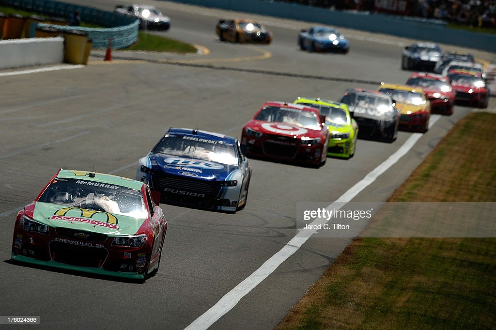Jamie McMurray, driver of the #1 McDonald's/Monopoly Chevrolet, leads a pack of cars during the NASCAR Sprint Cup Series Cheez-It 355 at The Glen at Watkins Glen International on August 11, 2013 in Watkins Glen, New York.