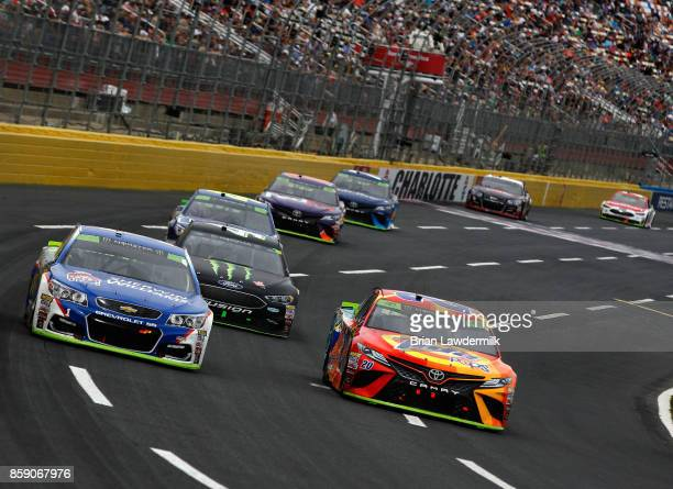 Jamie McMurray driver of the SherwinWilliams Chevrolet leads a pack of cars during the Monster Energy NASCAR Cup Series Bank of America 500 at...