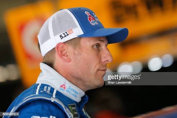 Jamie McMurray driver of the SherwinWilliams Chevrolet stands in the garage area during practice for the Monster Energy NASCAR Cup Series Bank of...