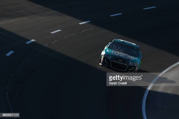 Jamie McMurray driver of the SherwinWilliams Emerald Chevrolet drives during qualifying for the Monster Energy NASCAR Cup Series O'Reilly Auto Parts...