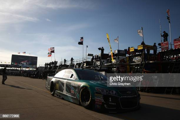 Jamie McMurray driver of the SherwinWilliams Emerald Chevrolet drives through the garage area during practice for the Monster Energy NASCAR Cup...