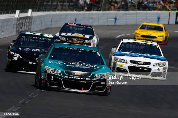Jamie McMurray driver of the SherwinWilliams Emerald Chevrolet leads a pack of cars during the Monster Energy NASCAR Cup Series O'Reilly Auto Parts...