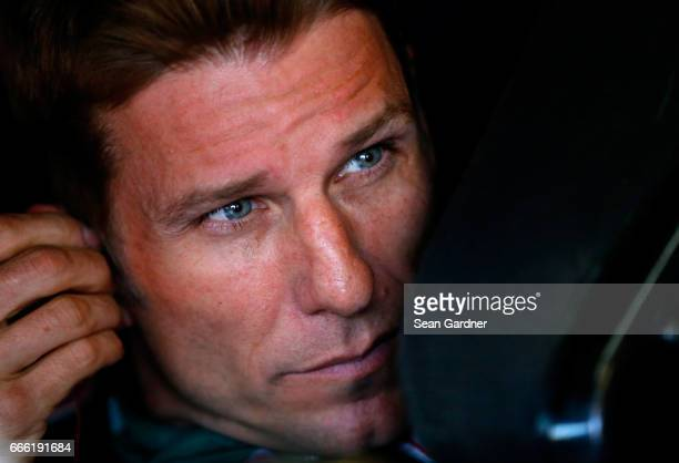 Jamie McMurray driver of the SherwinWilliams Emerald Chevrolet sits in his car during practice for the Monster Energy NASCAR Cup Series O'Reilly Auto...