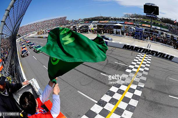 Jamie McMurray driver of the Widia Chevrolet and Ryan Newman driver of the Haas Automation Chevrolet lead the field to the green flag to start the...