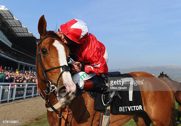 Jamie Moore and Sire de Grugy celebrate victory in the BetVictor Queen Mother Champion Chase during Ladies Day at Cheltenham Festival at Cheltenham...