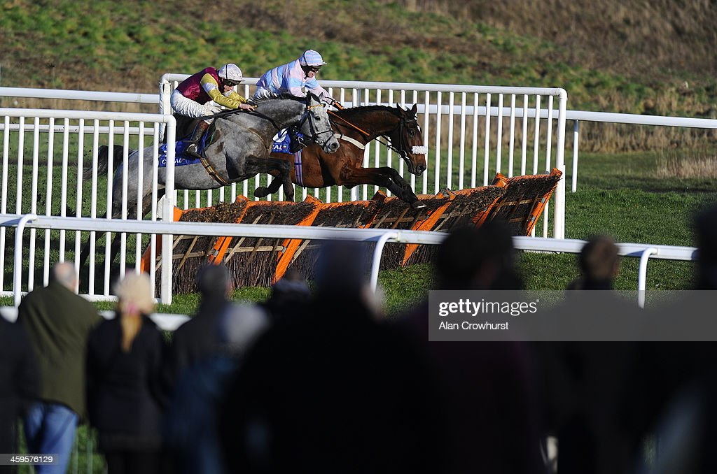 <a gi-track='captionPersonalityLinkClicked' href=/galleries/search?phrase=Jamie+Moore+-+Jockey&family=editorial&specificpeople=220586 ng-click='$event.stopPropagation()'>Jamie Moore</a> riding Awaywiththegreys (L) clear the last to win The Coral Spin Casino For iPad Handicap Hurdle Race at Chepstow racecourse on December 28, 2013 in Chepstow, Wales.
