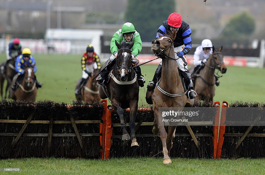 <a gi-track='captionPersonalityLinkClicked' href=/galleries/search?phrase=Jamie+Moore+-+Jockey&family=editorial&specificpeople=220586 ng-click='$event.stopPropagation()'>Jamie Moore</a> riding De Blacksmith (L) clear the last to win The attheraces.com & British Stallion STuds EBF 'National Hunt' Novices' Hurdle Race at Plumpton racecourse on January 06, 2013 in Plumpton, England.