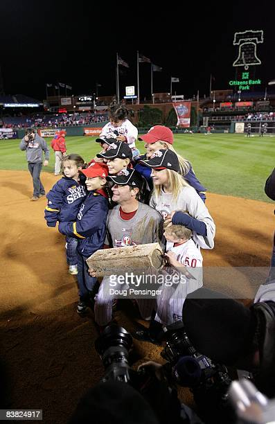 Jamie Moyer of the Philadelphia Phillies poses for a photo with his family while holding the pitcher's mound as they celebrate winning the World...