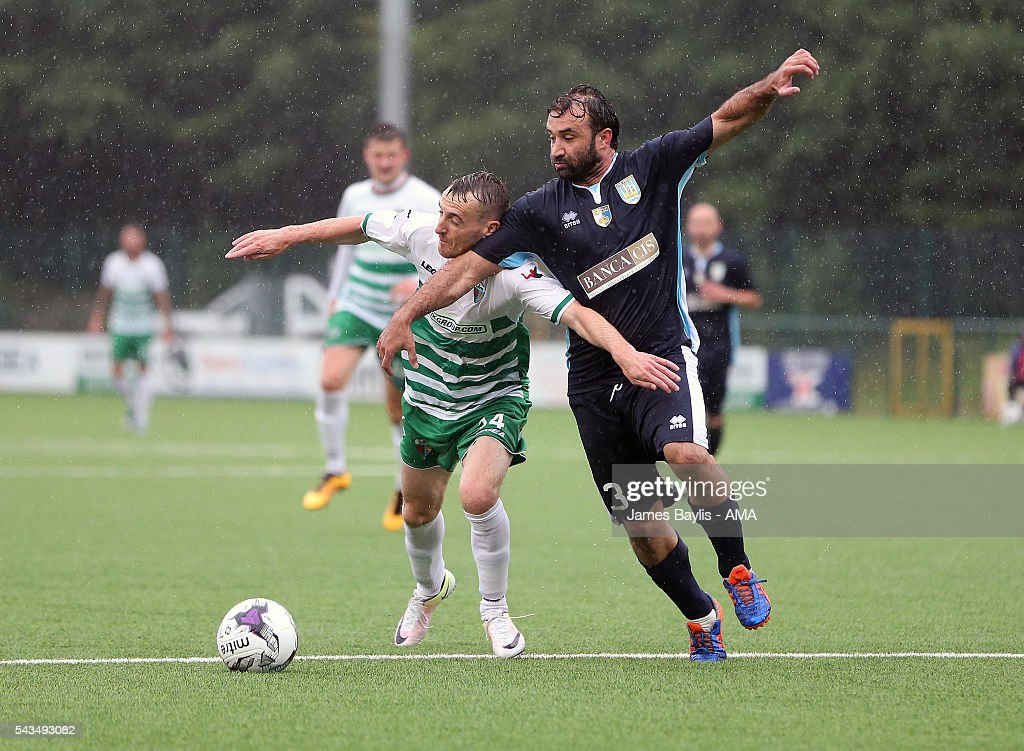 Jamie Mullan of The New Saints and Dario Merendino of SP Tre Penne during the UEFA Champions League First Round Qualifier match between The New Saints and SP Tre Penne at Park Hall on June 28, 2016 in Oswestry, England.