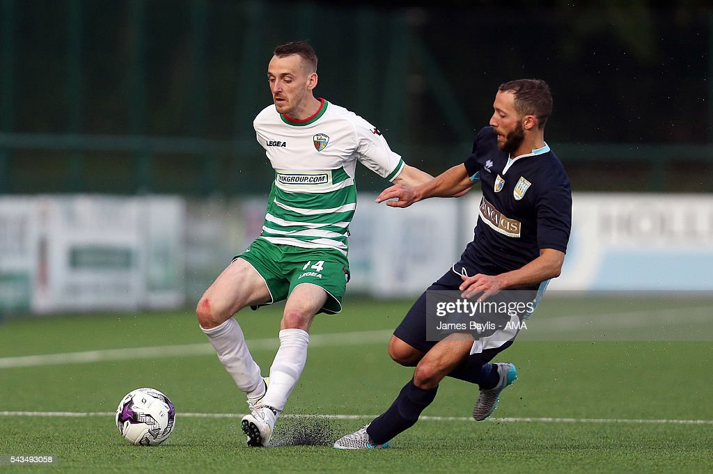 Jamie Mullan of The New Saints and Luca Patregnani of SP Tre Penne during the UEFA Champions League First Round Qualifier match between The New Saints and SP Tre Penne at Park Hall on June 28, 2016 in Oswestry, England.