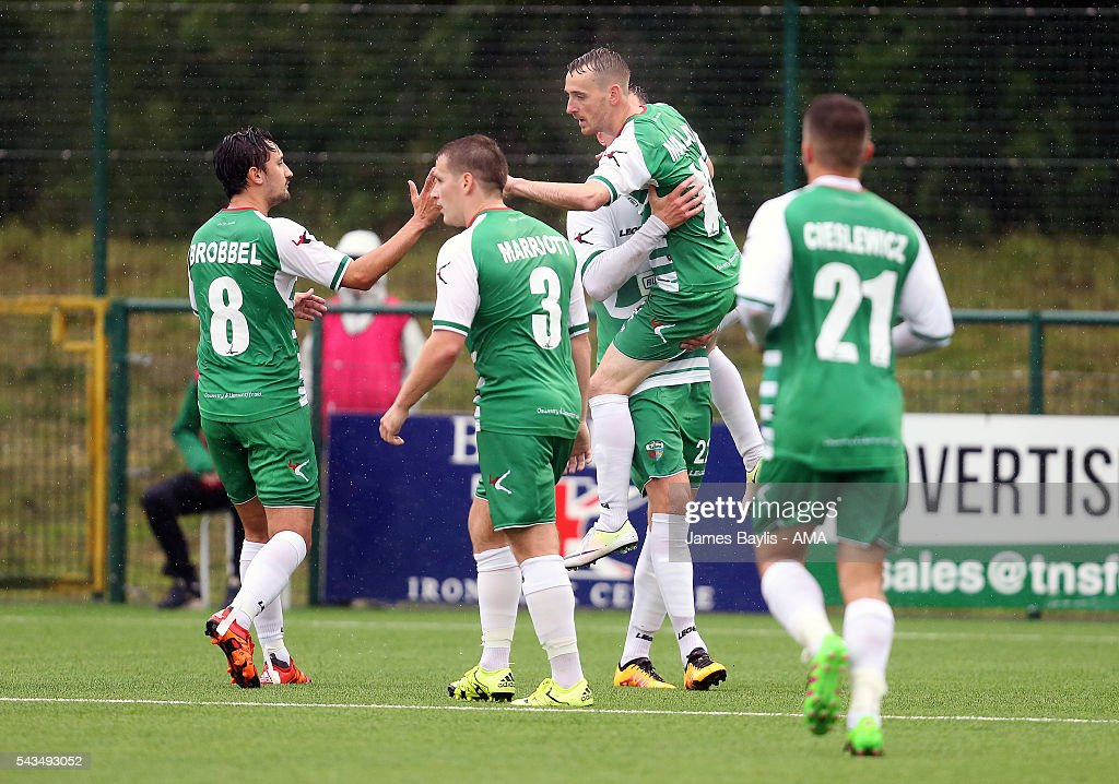 Jamie Mullan of The New Saints celebrates with his team-mates after scoring a goal to make it 2-1 during the UEFA Champions League First Round Qualifier match between The New Saints and SP Tre Penne at Park Hall on June 28, 2016 in Oswestry, England.