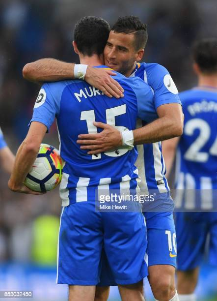 Jamie Murphy and Tomer Hemed of Brighton and Hove Albion celebrate victory after the Premier League match between Brighton and Hove Albion and...
