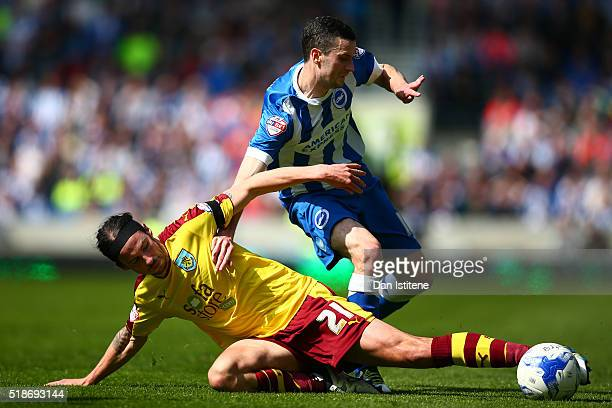 Jamie Murphy of Brighton Hove Albion battles for the ball with George Boyd of Burnley during the Sky Bet Championship match between Brighton Hove...