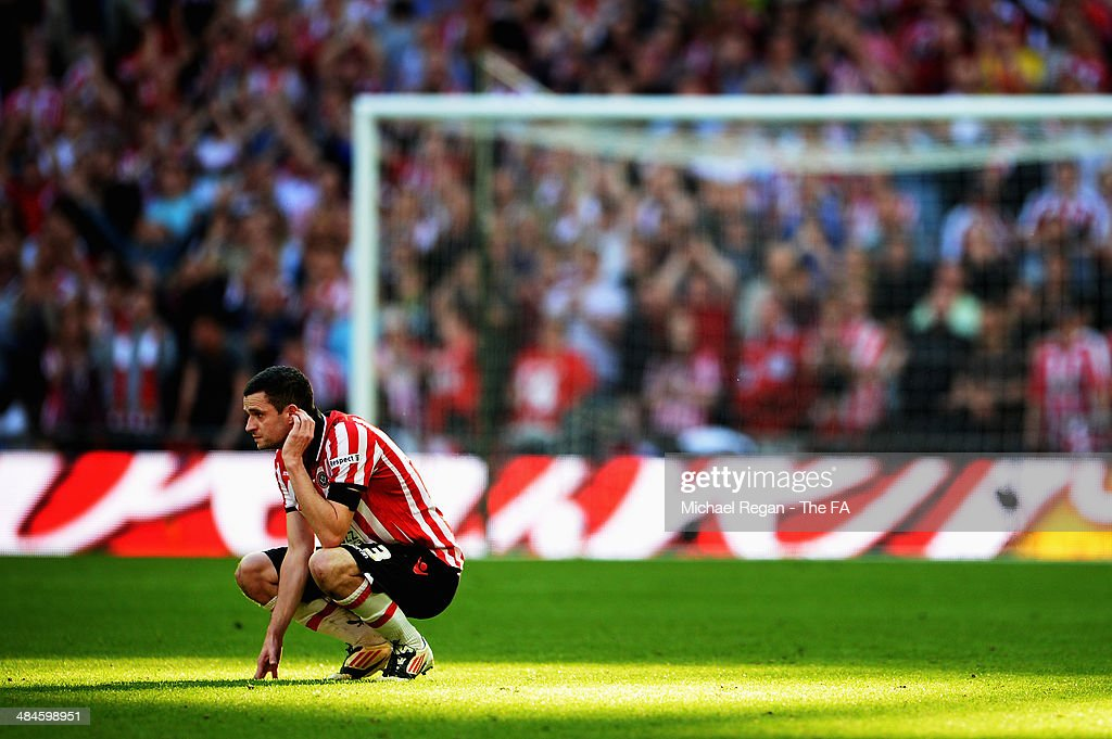 Jamie Murphy of Sheffield United appears dejected during the FA Cup Semi-Final match between Hull City and Sheffield United at Wembley Stadium on April 13, 2014 in London, England.