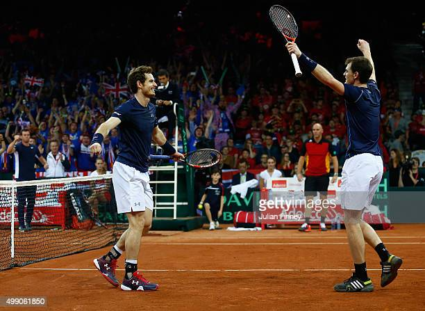 Jamie Murray and Andy Murray of Great Britain celebrate defeating Steve Darcis and David Goffin of Belgium in the doubles during day two of the Davis...