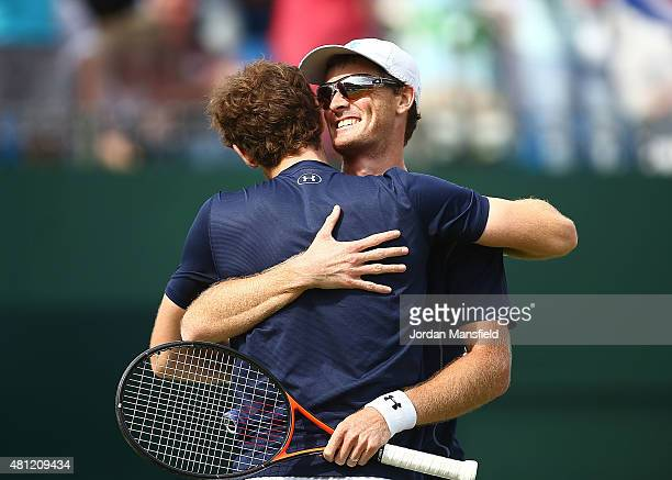 Jamie Murray and Andy Murray of Great Britain celebrate in their win against Nicolas Mahut and JoWilfried Tsonga of France during Day Two of the...