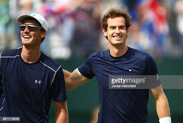 Jamie Murray and Andy Murray of Great Britain celebrate their win against Nicolas Mahut and JoWilfried Tsonga of France during Day Two of the World...