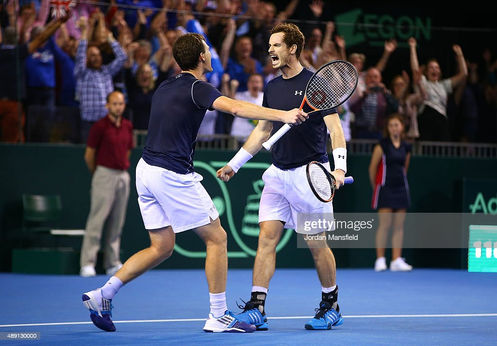 Jamie Murray (L) and Andy Murray of Great Britain celebrate victory in their Doubles match during Day Two of the Davis Cup Semi Final match between Great Britain and Australia at Emirates Arena on September 19, 2015 in Glasgow, Scotland.