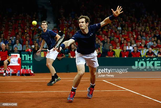 Jamie Murray and Andy Murray of Great Britain in action against Steve Darcis and David Goffin of Belgium in the doubles during day two of the Davis...